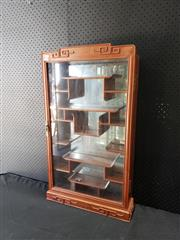 Sale 9014 - Lot 1050 - mall Chinese Rosewood Wall Display Cabinet, with stepped top, a glass panel door enclosing stepped shelves (h:82 x w:46 x d:12cm)