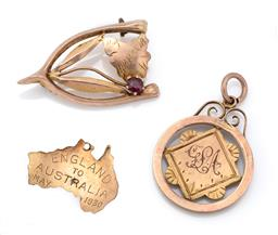 Sale 9107J - Lot 350 - THREE ANTIQUE AUSTRLAIN GOLD JEWELLERY ITEMS; 9ct gold wishbone brooch set with garnet top doublet and map of Tasmania with stamp fo...