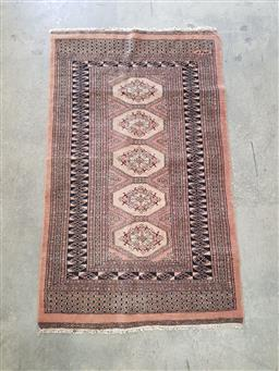 Sale 9102 - Lot 1153 - Hand knotted woollen Persian Rug in tan and black tones with central repeating guls (165 x 100cm)