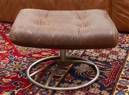 Sale 9239H - Lot 32 - A leather and metal ottoman, on swivel base, H 38cm x W 53cm x D 45cm.