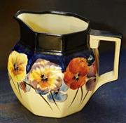 Sale 8320 - Lot 613 - Royal Doulton jug in large pansy design circa 1910