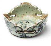 Sale 8575J - Lot 157 - An unusual Chinese blue and white dish with raised jagged sides and decorated with traditional males in a landscape, four character...