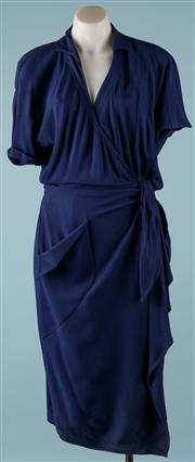 Sale 9090F - Lot 67 - A THIERRY MUGLER WRAP DRESS; size 42, navy blue, slightly padded to shoulders, 53% acetate and 47% viscose.