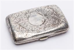Sale 9170H - Lot 87 - A sterling silver cigarette case, Birmingham, with scroll decoration, Length 7.5cm, with dents