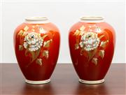 Sale 8774A - Lot 222 - A pair of  Wallendorf hand painted and gilt vases in russet with chrysanthemum, H x 18cm