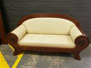 Sale 9048 - Lot 1045 - Biedermeier Mahogany Settee, with arched wide reeded back, the scrolled arms terminating in paw feet, upholstered in cream leather (...