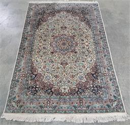Sale 9166 - Lot 1089 - Hand knotted pure wool Persian rug with floral border and central arabesque (216 x 138cm)