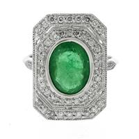 Sale 8221A - Lot 28 - Platinum Emerald and Diamond Deco Style Ring; centering an oval emerald estimated at 2.83ct, to surround of fifty round brilliant cu...