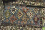 Sale 8359 - Lot 1081 - Small Antique Caucasian Wool Carpet, with small offset stars on a blue field with tulip border.