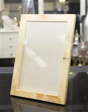 Sale 8709 - Lot 1082 - A photograph frame in bone effect, measuring 34.5 x 25cm