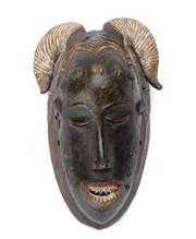 Sale 8864 - Lot 29 - Guro Mask, (Ivory Coast) 	 - Carved Wood and Pigments Bears stickers in Yellow ETH006 White J.O.F