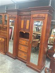 Sale 9031 - Lot 1014 - Late 19th Century Cedar & Silky Oak Breakfront or Beaconsfield Wardrobe, with dentil cornice, with two small central doors, open sh...