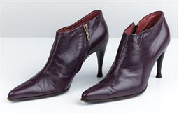 Sale 9091F - Lot 246 - A PAIR OF SERGIO ROSSI POINTED TOE ANKLE BOOTS; in purple with gold zip, size 37.