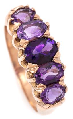 Sale 9128J - Lot 23 - A VICTORIAN STYLE AMETHYST RING; set across the top in 9ct gold with 5 graduated oval cut amethysts, size P1/2, width 8.5mm, wt. 5.38g.