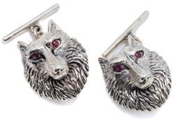 Sale 9132 - Lot 493 - A PAIR OF SILVER WOLF CUFFLINKS; wolf head links 21 x 16mm set with synthetic ruby eyes to bar backs, wt. 11.7g.