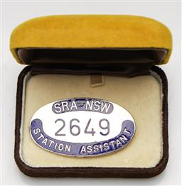 Sale 9253 - Lot 400 - Enamelled State Rail Authorty N.S.W. Station Assistant Badge