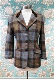 Sale 8577 - Lot 132 - A vintage Cyrillus Paris made in France, hand woven woollen Harris tweed jacket with green satin lining and brown velvet collar, s...