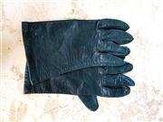 Sale 8577 - Lot 133 - A pair of vintage black leather gloves with silk inner lining, size medium, Condition: Good