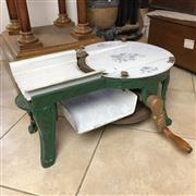 Sale 8795K - Lot 22 - An enamelled cast iron meat slicer