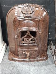 Sale 8843 - Lot 1006 - Cast Iron Kosi Heater by Metters