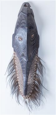Sale 8800 - Lot 88 - A PNG carved timber mask with cowrie shell insert and peacock feather beard, H 64cm