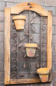 Sale 8575H - Lot 97 - A rustic timber and iron wall feature, with three terracotta herb pots