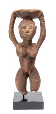 Sale 8864 - Lot 38 - Afo woman holding an offering bowl. (Southern Nigeria) - carved wood, red oxide.
