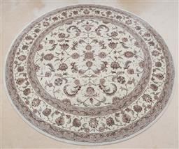 Sale 9155H - Lot 89 - A Hand tufted woollen circular carpet with silk inlay, dipicting repeating floral patten. Diameter 220cm