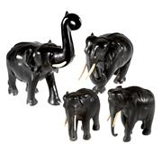 Sale 8000 - Lot 294 - A herd of four Siamese carved ebony elephants with boars tusks,