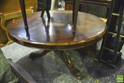 Sale 8359 - Lot 1016 - Victorian Rosewood Supper Table, the round top on turned pedestal with outswept legs (fault to apron moulding)