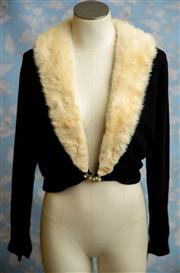 Sale 8577 - Lot 134 - A 1950s woollen crop cardigan featuring white mink fur collar, faux pearl and diamante waist button clasp, faux pearl embellishment...
