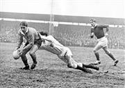 Sale 8754A - Lot 35 - Australia vs Western Countries, Memorial Ground, Bristol, England, 14 January 1967 - Australian Ken Catchpole being tackled by J. Mo...