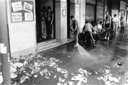 Sale 9082A - Lot 5050 - Clean up after Sydney Gay and Lesbian Mardi Gras Parade (1994) 25 x 20 cm, silver gelatin, Photographer: unknown