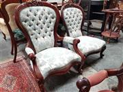 Sale 8925 - Lot 1081 - A pair of his and hers carved spoon back button upholstered chairs