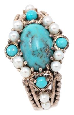 Sale 9132 - Lot 331 - A VICTORIAN STYLE SILVER TURQUOISE AND PEARL RING; centring a treated oval cabochon turquoise to surround and heart shoulders set wi...