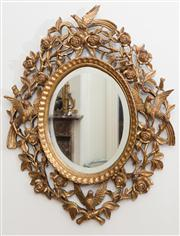 Sale 8435A - Lot 8 - A pierced and gilt oval bevelled edge wall mirror with roses and birds, H 68 x W 55cm
