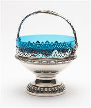 Sale 8575J - Lot 144 - A WMF Silverplate bonbonniere with pierced decoration raised on a pedestal with blue glass liner and handle, height 17cm