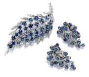 Sale 8928 - Lot 373 - A VINTAGE 18CT WHITE GOLD SAPPHIRE AND DIAMOND BROOCH AND EARRINGS SUITE; 68mm long leaf design brooch stem set with 22 baguette cut...