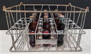 Sale 8949 - Lot 2096 - Vintage Metal Crate with 12 x Early Full 250ml Coca~Cola Bottles (Crete - H: 25, W: 47, D: 26cm)