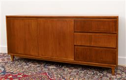 Sale 9239H - Lot 35 - A Mid-Century teak timber raised sideboard, with two doors beside three drawers, H 76.5cm x W 169cm x D 37cm.