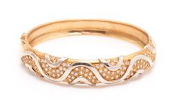 Sale 9260H - Lot 398 - An 18ct gold diamond bangle; 15mm wide hinged bangle, front set with waves of round brilliant cut diamonds with white gold highlight...