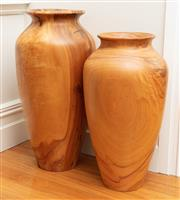 Sale 8863H - Lot 3 - Two graduated turned timber baluster vases, Height of taller 75cm
