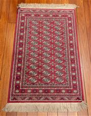 Sale 8882H - Lot 21 - A small machine woven carpet in the royal Bokhara pattern, 106cm x 67cm