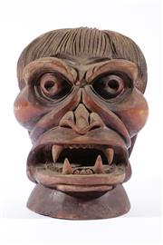 Sale 9007 - Lot 57 - A Carved Timber Deity Head H: 31cm