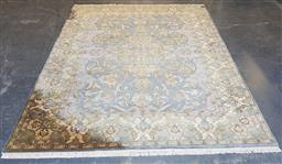 Sale 9179 - Lot 1034 - Hand-Knotted Indian Wool Carpet Retailed by Robyn Cosgrove, with medallion & arabesques, all in pale cream & blue tones (311 x 243cm)