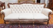 Sale 8435A - Lot 14 - A three piece Italian carved salon suite comprising a three seater and two armchairs upholstered in buttoned cream linen fabric