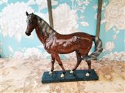 Sale 8500A - Lot 18 - A decorative mantel horse on stand - Composition: Resin - Condition: As New - Measurements:  21cm long x 24cm High