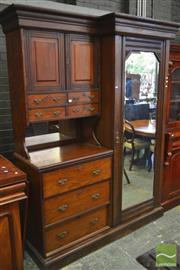 Sale 8282 - Lot 1078 - Late 19th Century Probably Blackwood Beaconsfield Wardrobe, with mirrored doors, two carved doors, open shelf & seven drawers (cor...