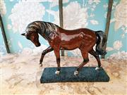 Sale 8500A - Lot 19 - A decorative mantel horse on stand - Composition: Resin - Condition: As New - Measurements:  25cm long x 21cm high