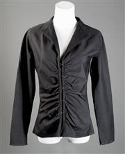 Sale 8499A - Lot 52 - A Gucci (Italian) cotton blend black long-sleeved shirt with gathered front and hook and eye clips. Size: 42. Small mend to underarm.